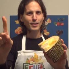 Man holding jackfruit - a still from a video