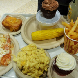 Tray Of Food With Mac And Cheese, Two Cupcakes, French Fries, Pizza, Etc.