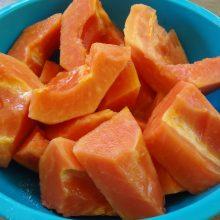 Papaya slices in blue bowl