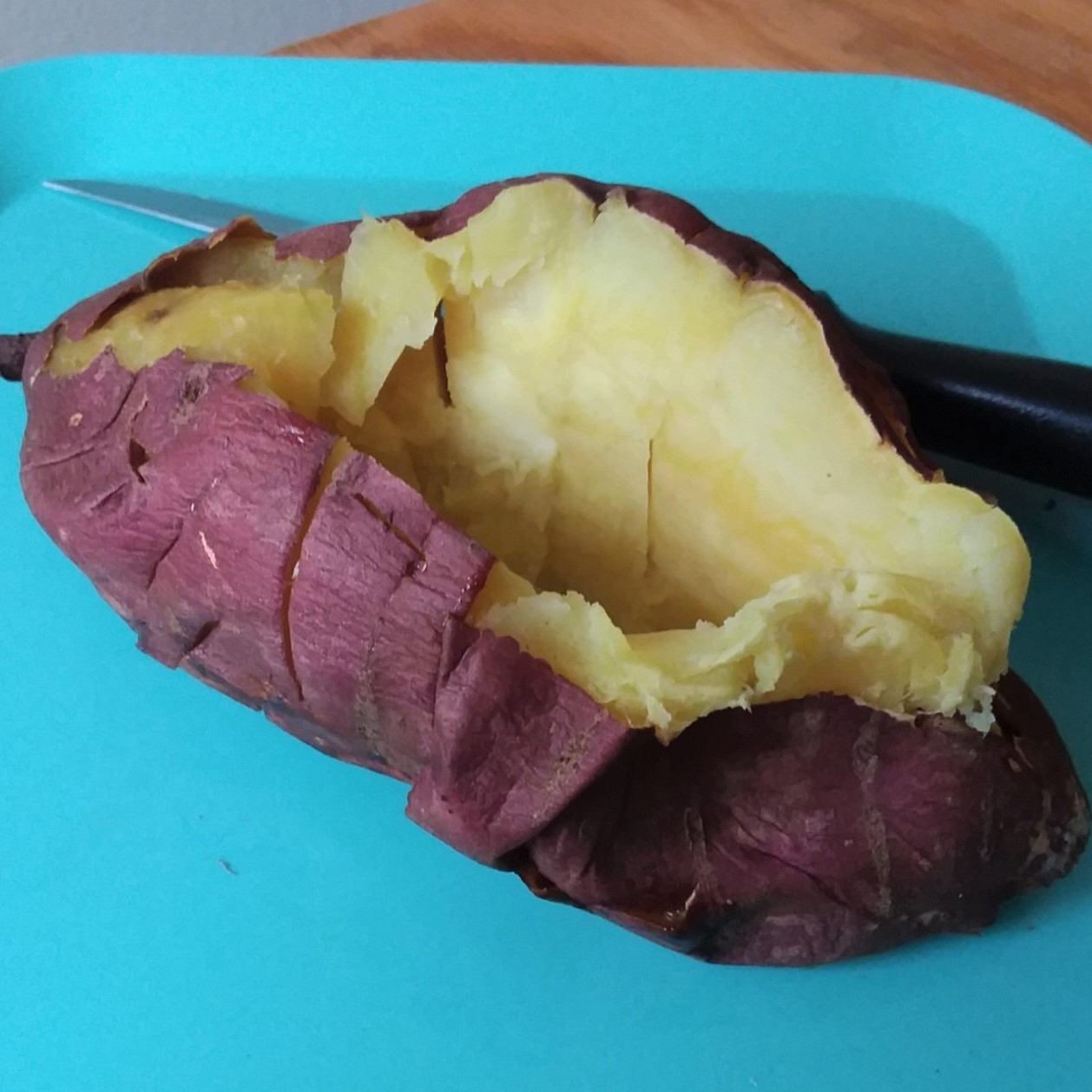 Japanese Yam On A Plate. Purple Outside, Yellow Inside